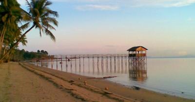 Menikmati Matahari Terbenam di Pantai Tanjung Bemban